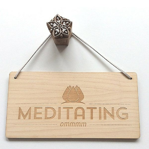 meditating door sign